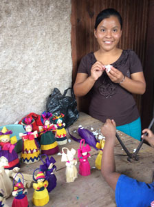 Helen making cornhusk dolls